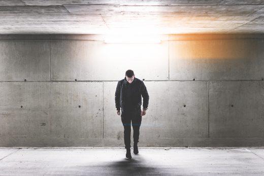 young-man-walking-in-conrete-underground-walkway-picjumbo-com